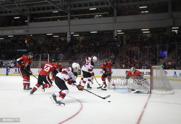 Andrew Hammond of the Ottawa Senators moves into position as Jesper Bratt of the New Jersey Devils carries the puck to the net during Kraft...