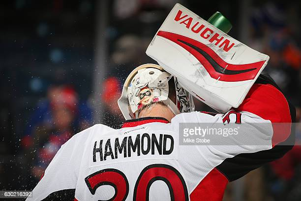 Andrew Hammond of the Ottawa Senators refreshes himself during the game against the New York Islanders at the Barclays Center on December 18 2016 in...
