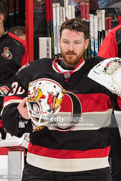 Andrew Hammond of the Ottawa Senators removes his mask on a break during an NHL game against the Vancouver Canucks at Canadian Tire Centre on...