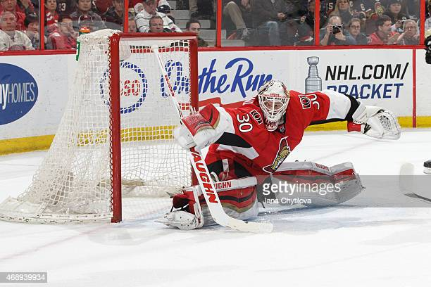 Andrew Hammond of the Ottawa Senators sprawls to make a save against the Pittsburgh Penguins at Canadian Tire Centre on April 7 2015 in Ottawa...