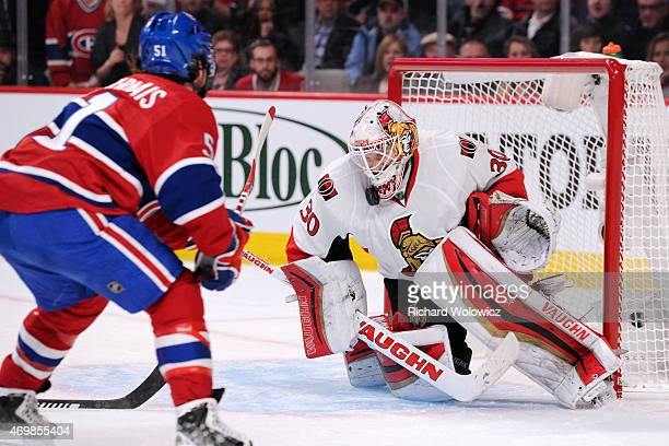 Andrew Hammond of the Ottawa Senators stops the puck on an attempt by David Desharnais of the Montreal Canadiens in Game One of the Eastern...