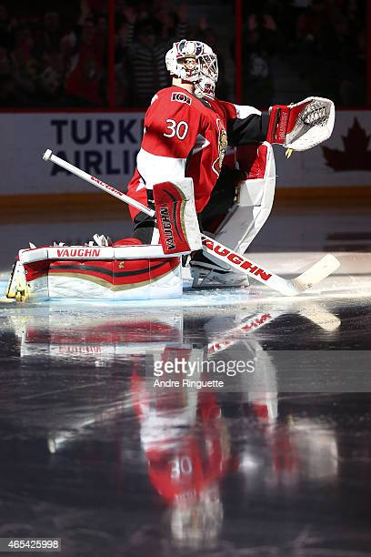 Andrew Hammond of the Ottawa Senators stretches in his crease during player introductions prior to a game against the Buffalo Sabres at Canadian Tire...