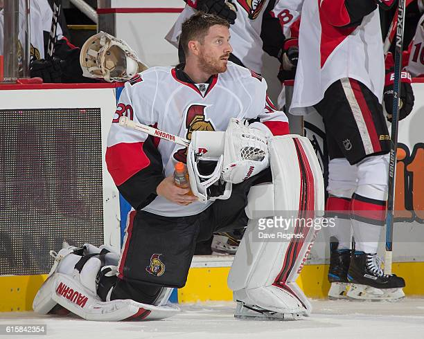Andrew Hammond of the Ottawa Senators stretches on a play stoppage during an NHL game against the Detroit Red Wings at Joe Louis Arena on October 17...