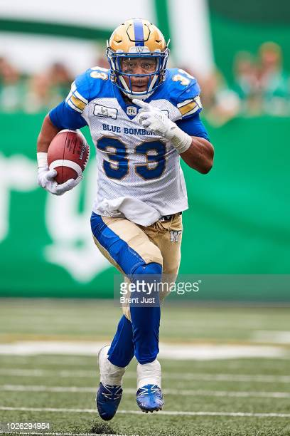 Andrew Harris of the Winnipeg Blue Bombers runs with the ball in the game between the Winnipeg Blue Bombers and Saskatchewan Roughriders at Mosaic...