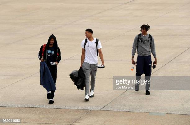 Andrew Harrison Ivan Rabb and Deyonta Davis of the Memphis Grizzlies board the team plane on March 18 2018 at Wilson Air Center in Memphis Tennessee...