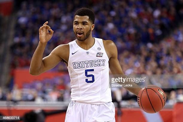 Andrew Harrison of the Kentucky Wildcats brings the ball up court in the first half against the Wisconsin Badgers during the NCAA Men's Final Four...