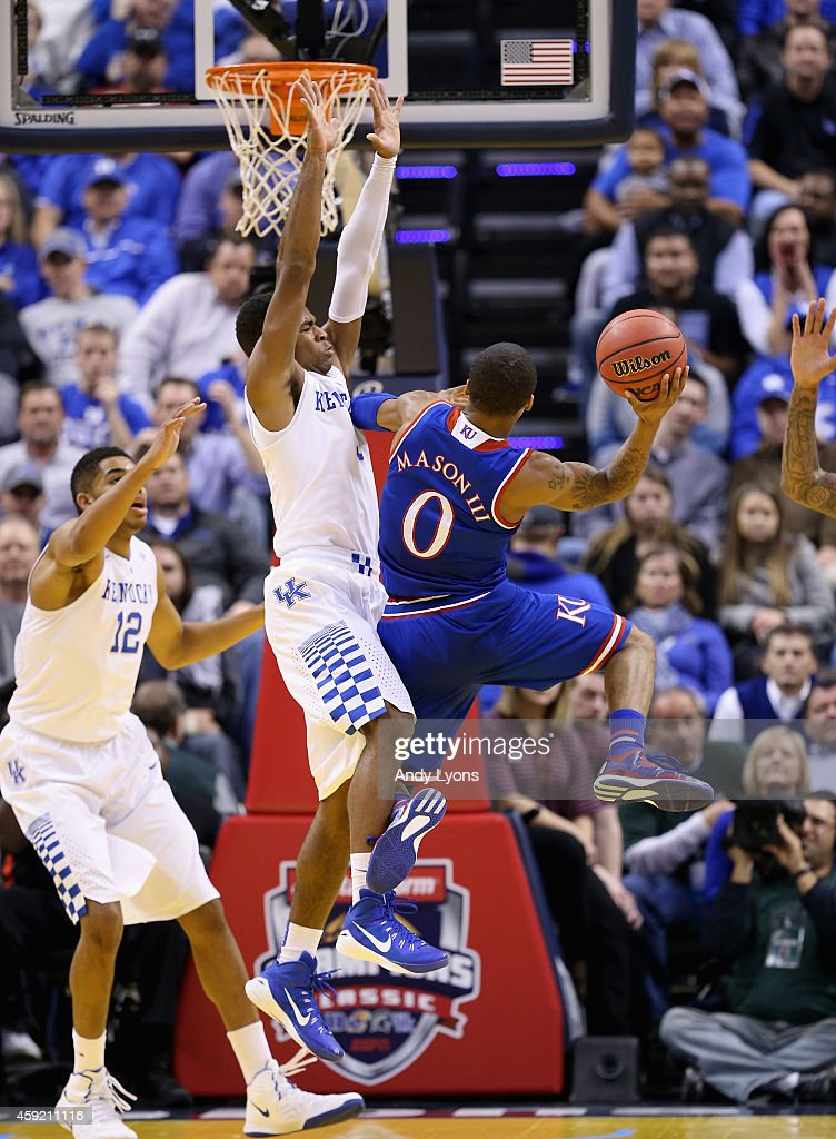 Andrew Harrison #5 of the Kentucky Wildcats defends the shot of Frank Mason III #0 of the Kansas Jayhawks in the State Farm Champions Classic at Bankers Life Fieldhouse on November 18, 2014 in Indianapolis, Indiana.
