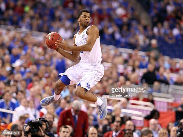 Andrew Harrison of the Kentucky Wildcats jumps and looks to pass in the first half against the Wisconsin Badgers during the NCAA Men's Final Four...