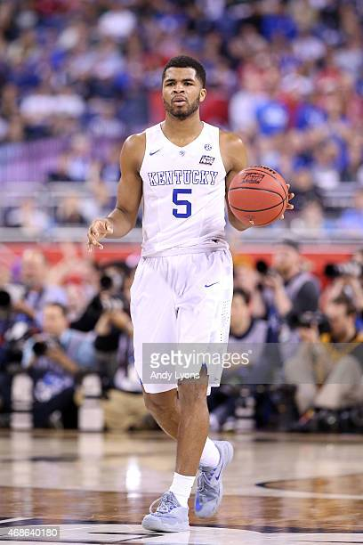 Andrew Harrison of the Kentucky Wildcats with the ball against the Wisconsin Badgers during the NCAA Men's Final Four Semifinal at Lucas Oil Stadium...