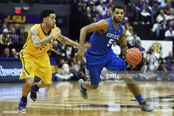Andrew Harrison of the Kentucky Wildcats works against Josh Gray of the LSU Tigers during a game at the Pete Maravich Assembly Center on February 10...