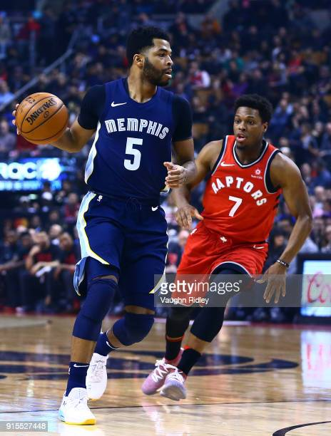 Andrew Harrison of the Memphis Grizzlies dribbles the ball as Kyle Lowry of the Toronto Raptors defends during the first half of an NBA game at Air...