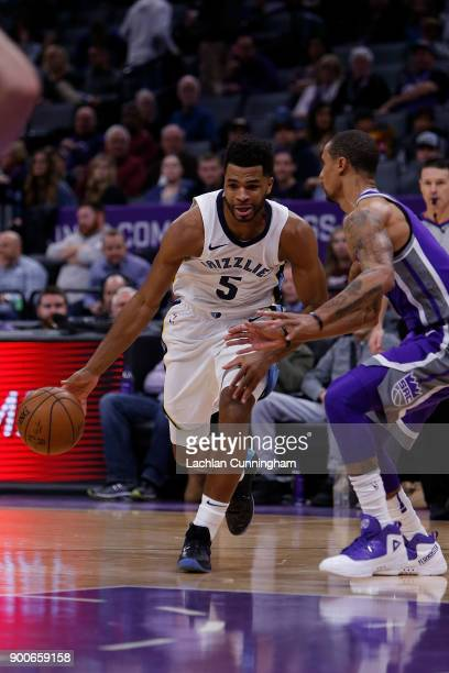 Andrew Harrison of the Memphis Grizzlies drives to the basket past George Hill of the Sacramento Kings at Golden 1 Center on December 31 2017 in...
