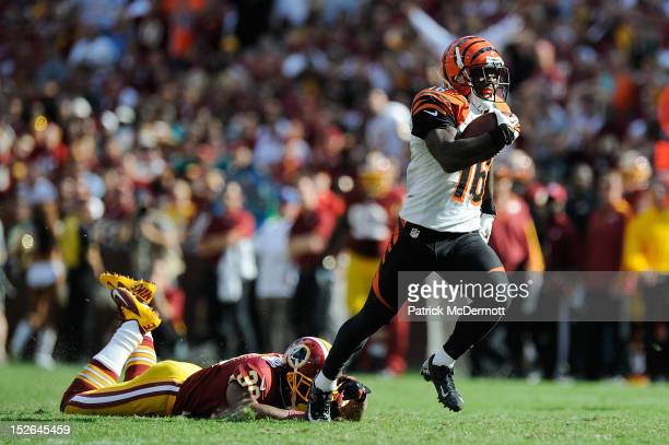 Andrew Hawkins of the Cincinnati Bengals avoids the tackle of Richard Crawford of the Washington Redskins on his way to scoring the gamewinning...