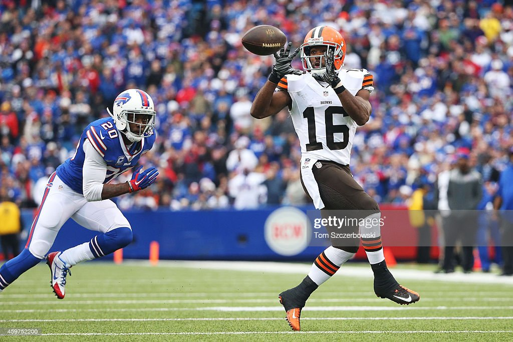 Andrew Hawkins #16 of the Cleveland Browns makes a catch as Corey Graham #20 of the Buffalo Bills defends during the first half at Ralph Wilson Stadium on November 30, 2014 in Orchard Park, New York.