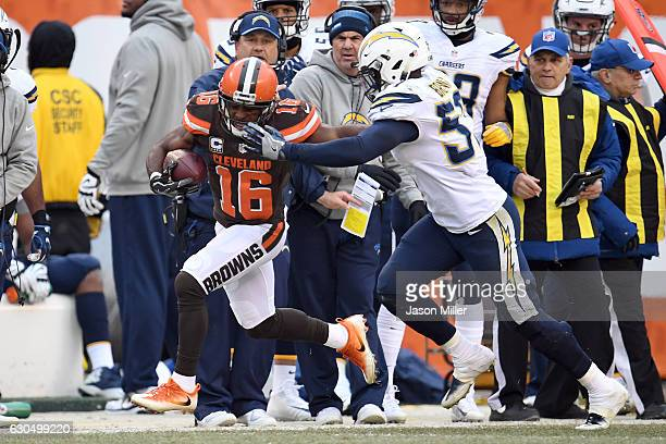 Andrew Hawkins of the Cleveland Browns runs after the catch against Jatavis Brown of the San Diego Chargers at FirstEnergy Stadium on December 24...