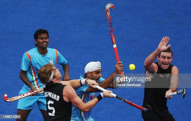 Andrew Hayward and Phillip Burrows of New Zealand challenge Danish Mujtaba and Gurwinder Singh Chandi of India for the ball during the Men's...