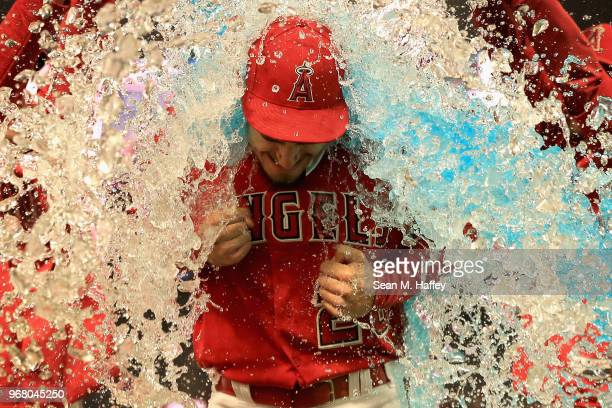 Andrew Heaney of the Los Angeles Angels of Anaheim has sports drink dumped on him by teammates after pitching a complete game one hitter defeating...