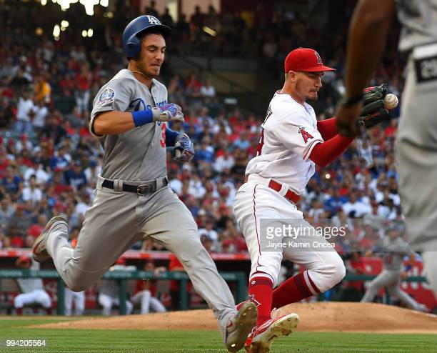 Andrew Heaney of the Los Angeles Angels of Anaheim takes the throw at first base for the force out on Cody Bellinger of the Los Angeles Dodgers in...