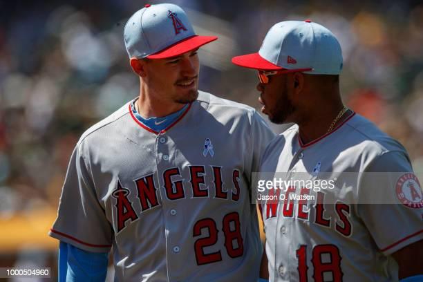 Andrew Heaney of the Los Angeles Angels of Anaheim talks to Luis Valbuena during the eighth inning against the Oakland Athletics at the Oakland...