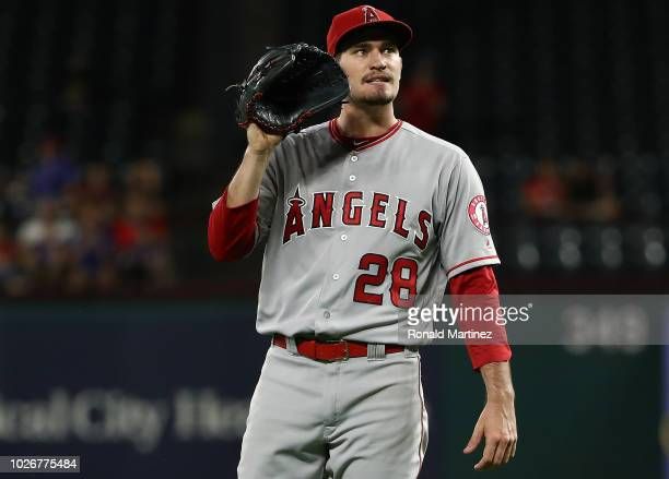 Andrew Heaney of the Los Angeles Angels steps off the mound after giving up a homerun against Adrian Beltre of the Texas Rangers the in the fourth...