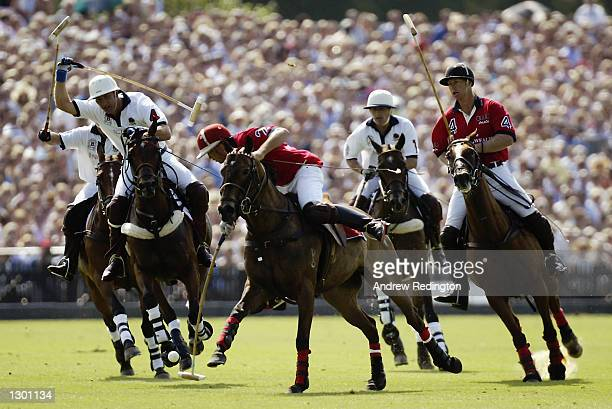 Andrew Hine of England prepares to shoot during Cartier International Polo Day played at the Smiths Lawn Polo Grounds in Windsor Great Park in...