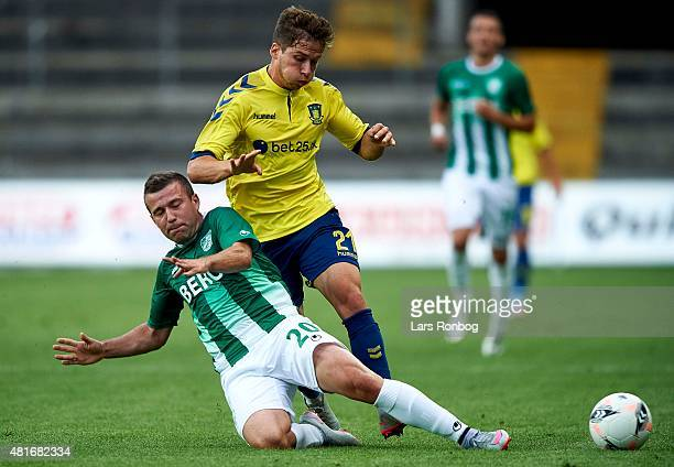 Andrew Hjulsager of Brondby IF and Nemanja Milisavljevic of PFC Beroe Stara Zagora compete for the ball during the UEFA Europa League Qualification...