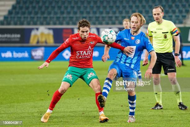 Andrew Hjulsager of KV Oostende and Roman Bezus of KAA Gent during the Jupiler Pro League match between KAA Gent and KV Oostende at Ghelamco Arena on...
