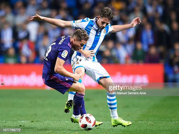 Andrew Hjulsager of RC Celta de Vigo duels for the ball with Adnan Januzaj of Real Sociedad during the Copa del Rey fourth round second leg match...
