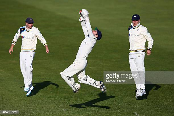 Andrew Hodd the wicketkeeper of Yorkshire leaps high to collect a delivery from Liam Plunkett as Adam Lyth and Gary Ballance look on during day two...