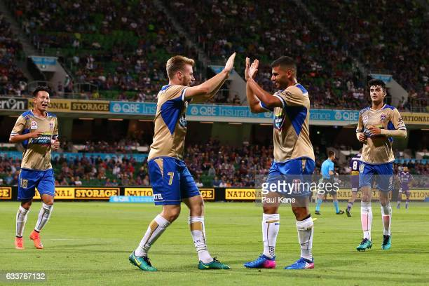 Andrew Hoole and Andrew Nabbout of the Jets celebrate a goal during the round 18 ALeague match between the Perth Glory and the Newcastle Jets at nib...