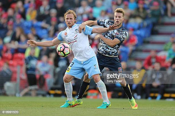 Andrew Hoole of the Jets and Rhyan Grant of Sydney FC contest the ball during the round four ALeague match between the Newcastle jets and Sydney FC...