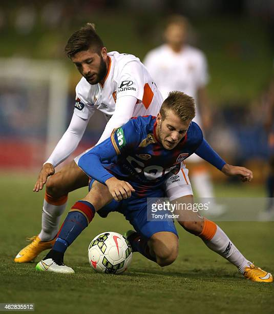 Andrew Hoole of the Jets contests the ball with Brandon Borrello of the Roar during the round 16 ALeague match between the Newcastle Jets and...