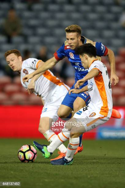 Andrew Hoole of the Jets contests the ball with Joe Caletti of the Roar during the round 22 ALeague match between the Newcastle Jets and the Brisbane...