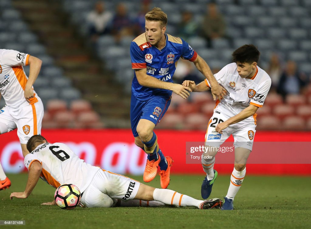 Andrew Hoole of the Jets contests the ball with Joe Caletti of the Roar during the round 22 A-League match between the Newcastle Jets and the Brisbane Roar at McDonald Jones Stadium on March 5, 2017 in Newcastle, Australia.