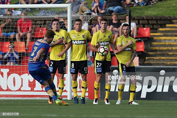 Andrew Hoole of the Jets takes a free kick defended by Storm Roux Nick Montgomery Jake McGing and Roy O'Donovan during the round seven ALeague match...