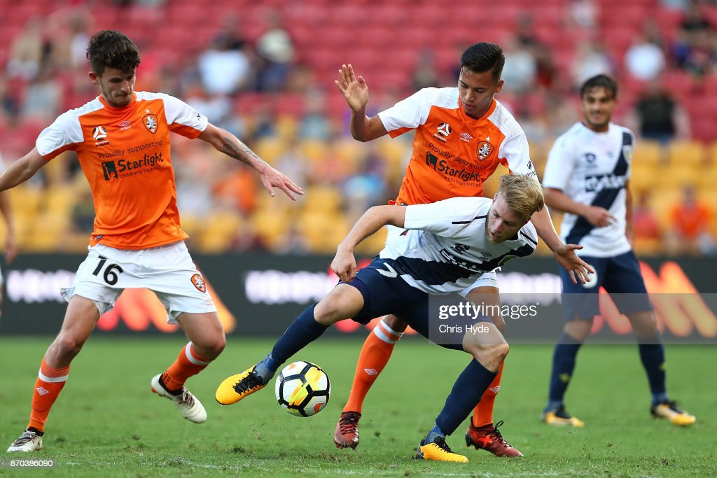 Andrew Hoole of the Mariners and Dane Ingham of the Roar compete for the ball during the round five A-League match between the Brisbane Roar and the Central Coast Mariners at Suncorp Stadium on November 5, 2017 in Brisbane, Australia.
