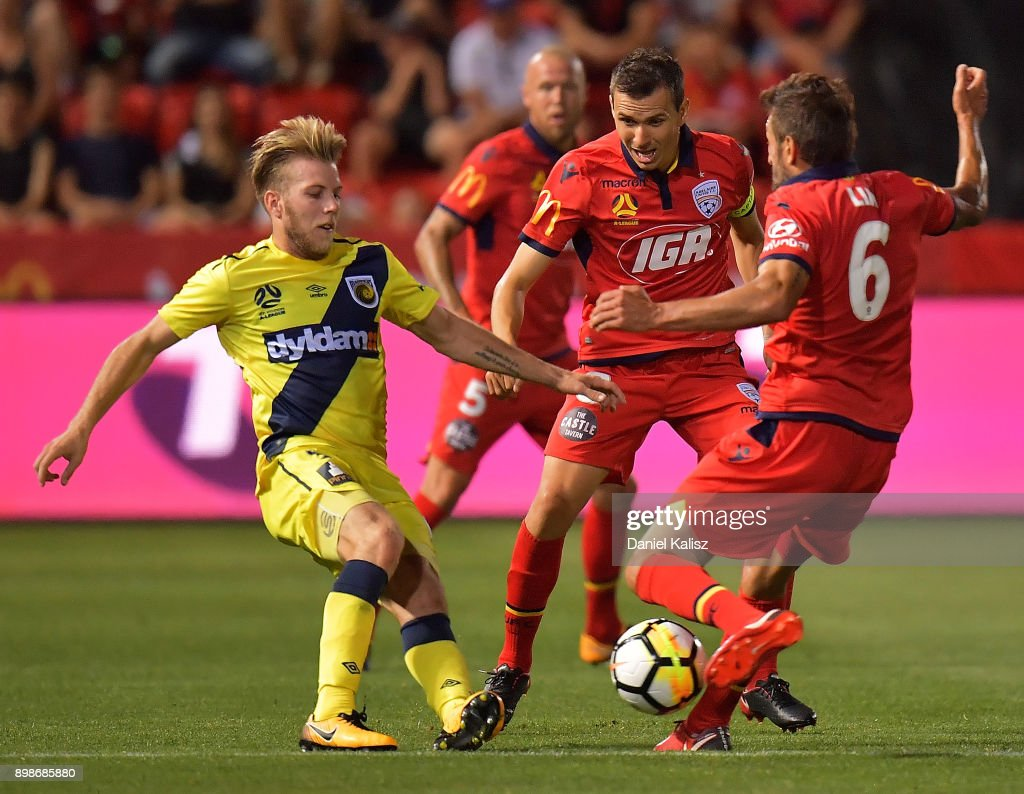 Andrew Hoole of the Mariners and Vince Lia of United compete for the ball during the round 12 A-League match between Adelaide United and the Central Coast Mariners at Coopers Stadium on December 26, 2017 in Adelaide, Australia.