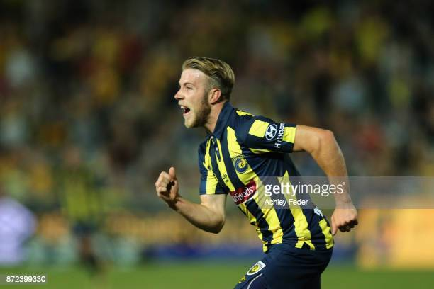 Andrew Hoole of the Mariners celebrates his goal with team mates during the round six ALeague match between the Central Coast Mariners and Sydney FC...
