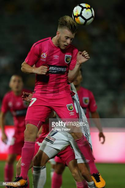 Andrew Hoole of the Mariners heads the ball during the round four A-League match between the Central Coast Mariners and the Melbourne Victory at...