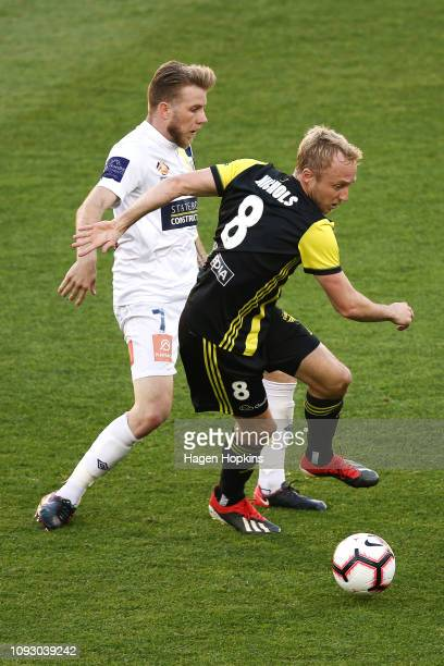 Andrew Hoole of the Mariners tackles Mitch Nichols of the Phoenix during the round 13 ALeague match between the Wellington Phoenix and the Central...