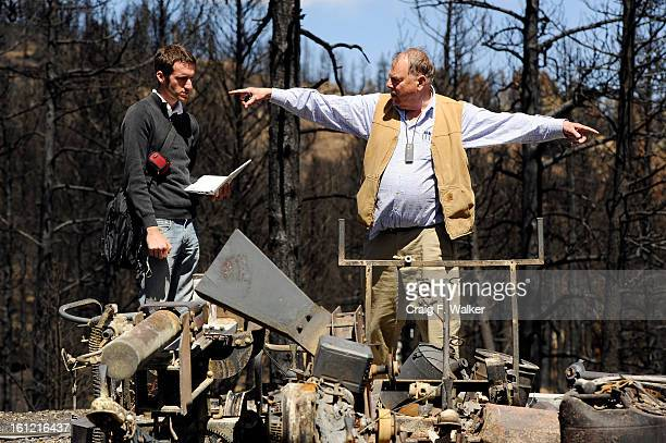 Andrew Hoover right talks with Evan Doukas of Adjusters International at his home that was destroyed in the Lower North Fork fire Littleton CO Friday...