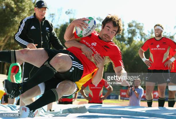 Andrew Hore of the All Blacks is tackled onto a high jump mat during the New Zealand All Blacks Training Session at Xerox Arena on August 16, 2011 in...
