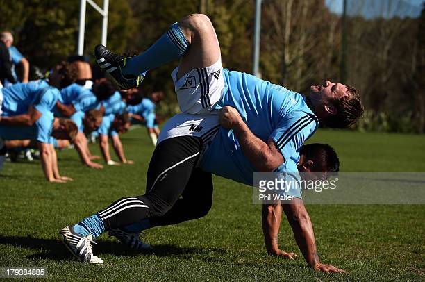 Andrew Hore of the All Blacks takes a ride on top of Keven Mealamu during a New Zealand All Blacks training session at Beetham Park on September 3...