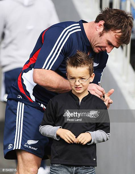 Andrew Hore signs an autograph for a young fan during the New Zealand All Blacks captain's run at Eden Park on June 13, 2008 in Auckland, New Zealand.