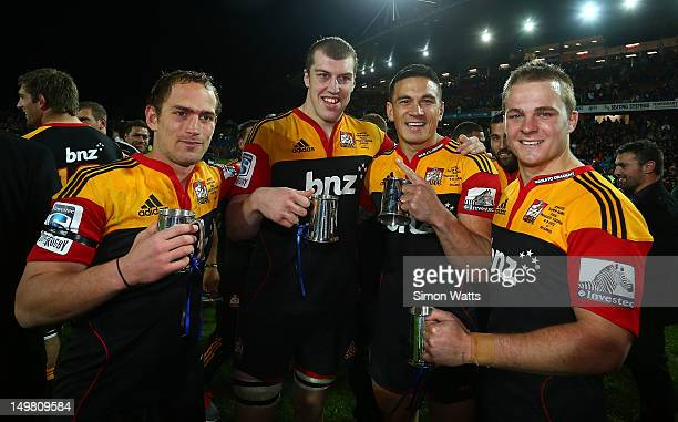 Andrew Horrell, Brodie Rettalick, Sonny Bill Williams and Sam Cane celebrate defeating the Sharks to win the Super Rugby Cup during the Super Rugby...
