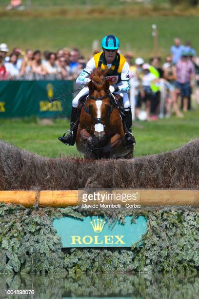 Andrew Hoy of Australia riding Vassily de Lassos during the obstacle in the water of the Cross Country test DHLPrize in the park of the CHIO of...