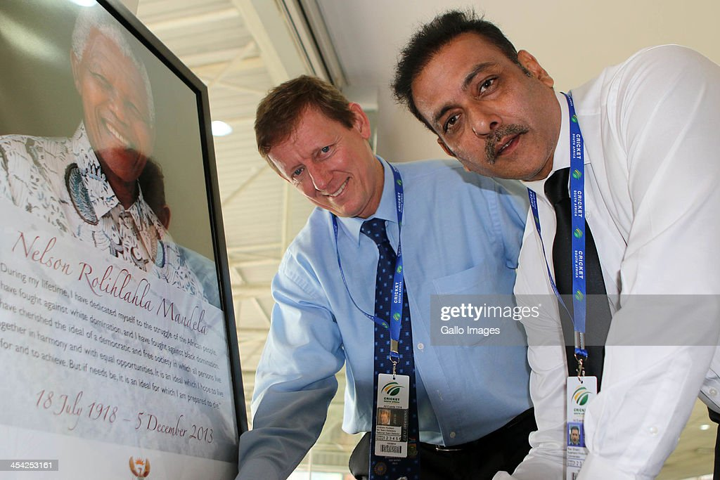 Andrew Hudson ( l) and Ravi Shastri sign the book of Condolences for Nelson Mandela during the 2nd Momentum ODI match between South Africa and India at Sahara Stadium Kingsmead on December 08, 2013 in Durban, South Africa.