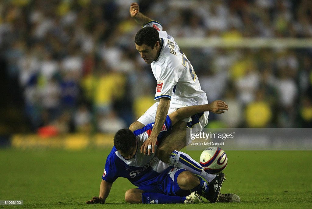 Andrew Hughes of Leeds tackles Evan Horwood of Carlisle during the League 1 Playoff Semi Final, 1st Leg match between Leeds United and Carlisle United at Elland Road on May 12, 2008 in Leeds, England.