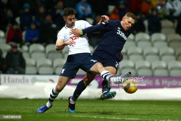 Andrew Hughes of Preston North End and Martyn Waghorn of Derby County in action during the Sky Bet Championship match between Preston North End and...