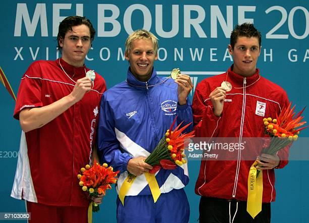 Andrew Hurd of Canada David Carry of Scotland and David Davies of Wales pose for photographers after the presentation of medals in the men's 400m...